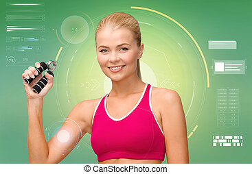 sporty woman with expander over green background - fitness,...