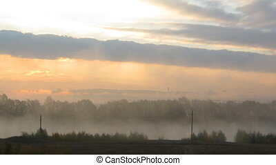 rural mist landscape with sunrise over lake