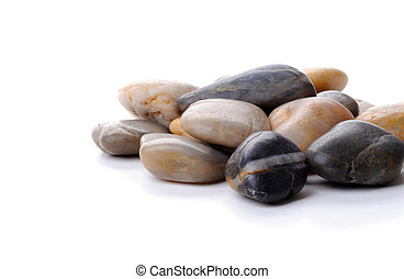 Polished Rocks - Pile of polished river rocks on a white...