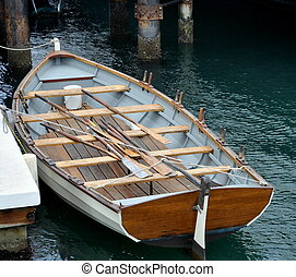 Wooden Rowboat - A Wooden Rowboat at a Dock