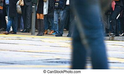Pedestrians cross the street. Close-up with legs - HONG...