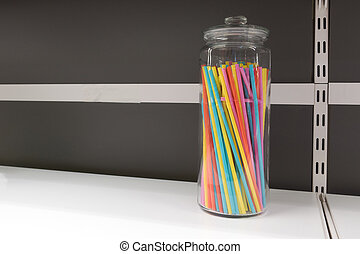 colorful plastic tubes in glass jar