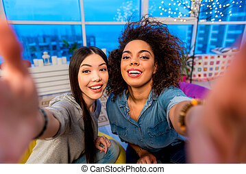 Outgoing women taking photo at camera - Top view of portrait...