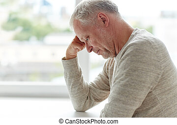 close up of senior man thinking - old age, problem and...