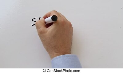 Writing a shopping list on whiteboard