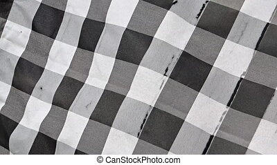 Checkered Balinese traditional pattern. Fabric swaying in...