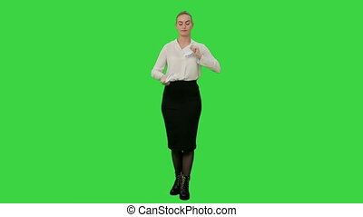 Young angry woman rips a sheet of paper and throws it toward the camera on a Green Screen, Chroma Key.