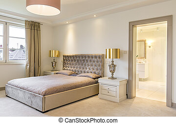 Luxurious bedroom interior with a large bed