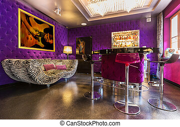 Spacious interior with upholstered violet walls - Spacious...
