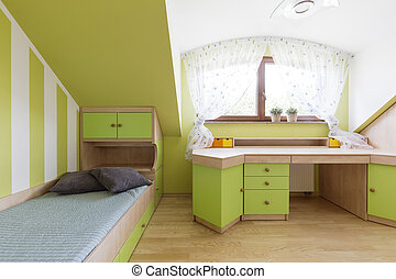 Unisex children's room in green, with functional desk and...