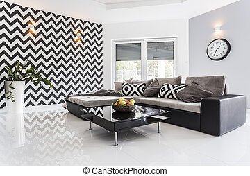 Posh living room with white tiled floor and black lounge set