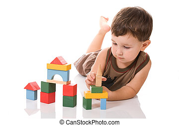 Boy and blocks - Little boy on the floor is played with...