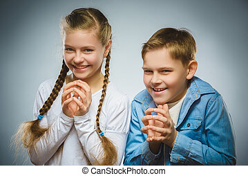 Cunning boy and girl conceived trick. Communication concept....
