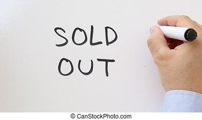 Sold Out written on whiteboard - Whiteboard writing business...