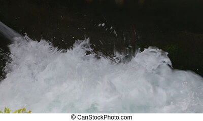 Splashing water with black background - Shot of Splashing...