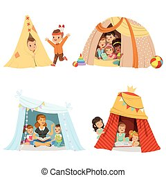 Cute little children playing and sitting in a tent teepee,...
