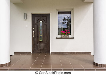 Porches villa entrance idea - Exterior view of a porches...