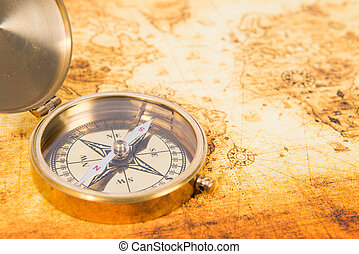 Old map with an ancient compass