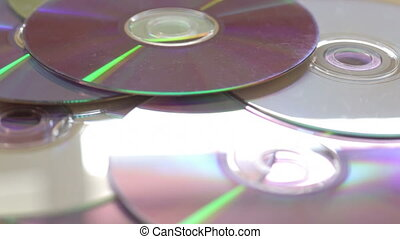 Side views of DVD media rotate - Shot of Side views of DVD...