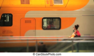 slow motion of passengers at a train station - Shot of slow...
