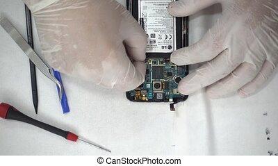Smartphone repair in a lab top view - Smartphone at repair...