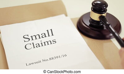 Small claims lawsuit verdict folder with gavel placed on...