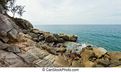 Rocky sea coast on Phuket island. Shot with panning - The...