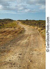 Gravel road perspective - Gravel road throught dry...