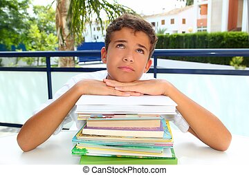 boy student teenager bored thinking with books