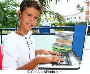 teenager student happy boy laptop earphones