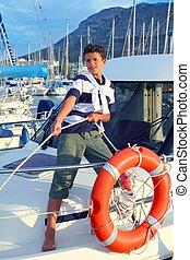 Boy teen sailor mooring boat rope in harbor summer marina...