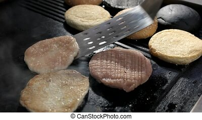 Spatula and burger patties. Food on pan. How to cook chicken...