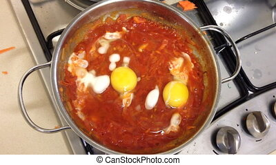 Shakshuka also known as eggs poached in a sauce of tomatoes...