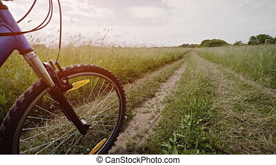 Perspective Clip of a Mountain Bike Tire Riding over Muddy...