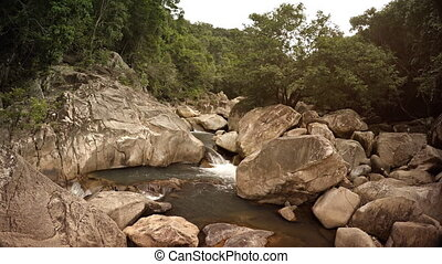 Wild Mountain Creek Tumbles along Rocky Course in Vietnam,...