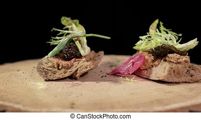 Onion and bacon jelly sandwiches. Food on wooden board...