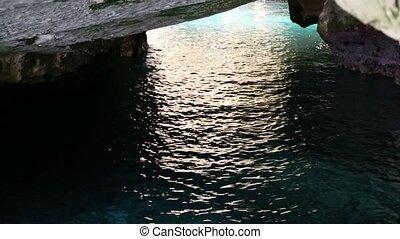Sea water inside dark grottoes - Shot of Sea water inside...