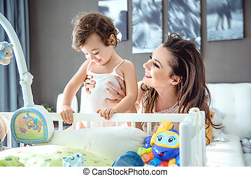 Delighted mom having fun with her child
