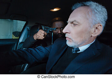 Cheerless worried man sitting in his car - Becoming a...