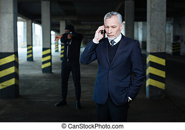 Anxious serious businessman making a call - Call to...