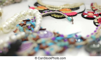 Different jewelry on a table - Different jewelry placed on a...