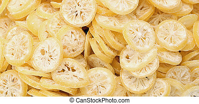 background of slices of dried lemons - background of slices...