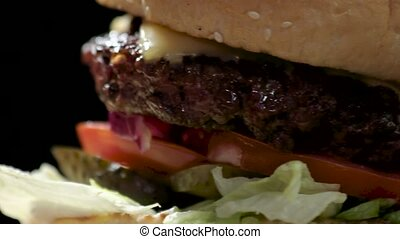 Burger on black background. Grilled meat and fresh...
