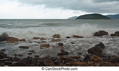 Waves Roll and Beak over a Rocky Vietnamese Beach - Ocean...