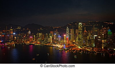 Night Time Cityscape over a Harbor with Colorful Lights -...