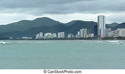 Nha Trang Cityscape over a Tropical Beach on a Cloudy Day -...