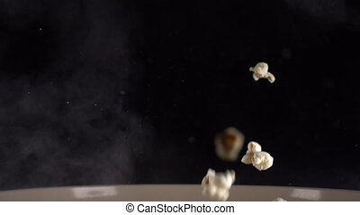 Popcorn flies during cooking, slow motion