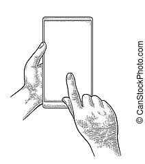 Male hands holding and touching a large mobile phone....