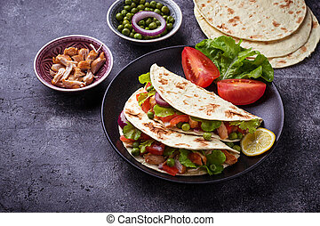 Mexican tacos with meat and vegetable. Selective focus