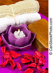 spa attributes: candles, flower petals and other